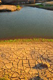 Arid land and lake Stock Photo