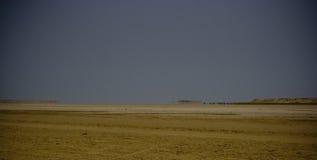 Arid landscape with mirage. Arid landscape near Sahara Desert, mirage Stock Photography