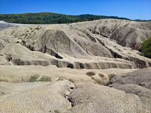 Arid landscape at the Mud Volcanoes royalty free stock images