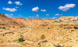 Arid landscape near Chenini in South Tunisia. Arid landscape near Chenini in Tataouine Governorate, South Tunisia Royalty Free Stock Photography