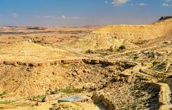 Arid landscape near Chenini in South Tunisia. Arid landscape near Chenini in Tataouine Governorate, South Tunisia Stock Image