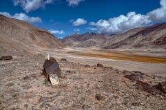 Arid landscape in Tajikistan. Scenic arid valley in Pamir mountains in Tajikistan Stock Photo