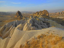 Arid landscape and volcanic rock pillars. In the Cappadocia region of Turkey Royalty Free Stock Images