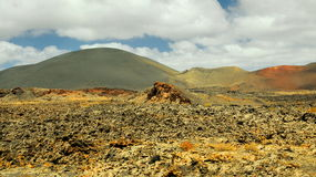Arid landscape with volcanoes, in Timanfaya National Park, Lanzarote, Spain Royalty Free Stock Photography