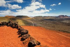 Arid landscape with volcanoes, in Timanfaya National Park, Lanzarote, Spain Royalty Free Stock Image