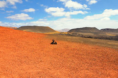 Arid landscape with volcanoes, in Timanfaya National Park, Lanzarote, Spain Stock Images
