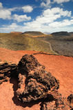 Arid landscape with volcanoes, in Timanfaya National Park, Lanzarote, Spain Royalty Free Stock Photos