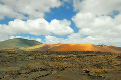 Arid landscape with volcanoes, in Timanfaya National Park, Lanzarote, Spain Stock Photo