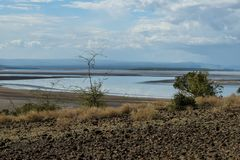 Lake against a mountain background, Lak Magadi stock image