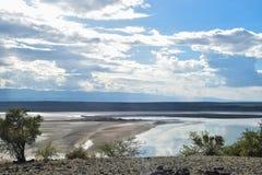 Lake against a mountain background, Lak Magadi royalty free stock image