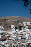 Arid lanscape in Lindos. At the arrival in Lindos this was the first scenary we saw: arid hills and white architecture on a excesive blue sky royalty free stock photos
