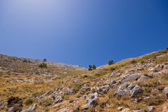Arid mountain and a blue sky. The picture shows an arid mountain and a sunny blue sky at the Costa del Sol in Spain Royalty Free Stock Photo