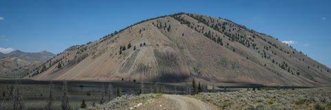 Arid mountain and gravel road Stock Photography