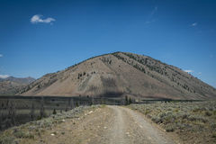 Arid mountain and gravel road Royalty Free Stock Photo