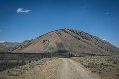 Arid mountain and gravel road Royalty Free Stock Photo