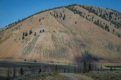 Arid mountain and gravel road Stock Photo