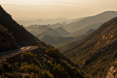 Arid mountain landscape. Dry arid mountain pass landscape with panoramic views of distant hills and mountains Royalty Free Stock Photography