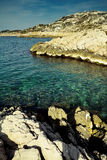 Arid rocky shores. Of Calanques with sea and sky in Marseille, France Stock Photos