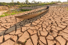Arid soil with old boat. In summer season Royalty Free Stock Image