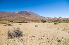 Arid and stony landscape of caldera with view on volcano Teide. Tenerife, Canary islands, Spain Royalty Free Stock Photography