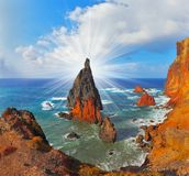 Arid  tip of Madeira. Atlantic storms. Colorful pinnacles lit sunset. Arid eastern tip of the island of Madeira Royalty Free Stock Image