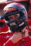 Arie Luyendyk Indy Car Driver. Arie Luyendyk Indy race car driver putting on his racing helmet before getting into his car stock photography