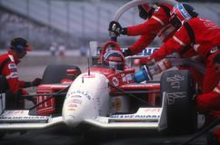 Arie Luyendyk Indy Car Driver. Arie Luyendyk Indy race car driver sitting in his car during a pit stop getting fuel in the car royalty free stock images