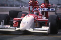 Arie Luyendyk Indy Car Driver. Arie Luyendyk Indy race car driver sitting in his car during a pit stop getting fuel in the car royalty free stock photo