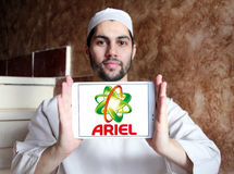 Ariel laundry detergent logo. Logo of ariel laundry detergent or washing powder on samsung tablet holded by arab muslim man Royalty Free Stock Images