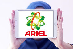 Ariel laundry detergent logo. Logo of ariel laundry detergent or washing powder on samsung tablet holded by arab muslim woman Stock Photography