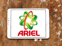 Ariel laundry detergent logo. Logo of ariel laundry detergent or washing powder on samsung tablet on wooden background Stock Image