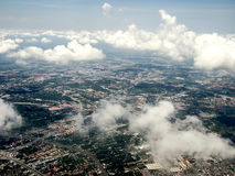 Ariel view of the city through the clouds Stock Image