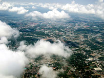 Ariel view of the city through the clouds Stock Photography