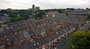 Ariel view of the city of durham showing streets of old brick houses the cathedral and castle. With trees on the skyline Royalty Free Stock Photo