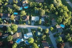 Ariel view of houses. Within treed area with pools Stock Photo