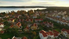 Ariel view of houses in Sweden. In autumn stock video