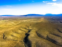 Ariel View of Taos New Mexico from a Hot Air Balloon. Set sail on a hot air balloon adventure with this Ariel view of Taos New Mexico at the Rio Grande Gorge and royalty free stock photos