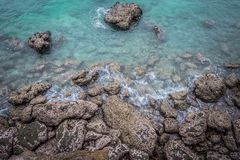Ariel view of transparent clear sea water with rocks, beautiful nature background. stock images