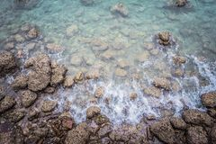 Ariel view of transparent clear sea water with rocks, beautiful nature background. stock photo