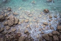 Ariel view of transparent clear sea water with rocks, beautiful nature background. stock photography