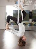 Ariel Yoga Woman. Photo of woman doing ariel yoga pose Royalty Free Stock Photography