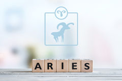 Aries star sign on a table. Aries star sign on a wooden table royalty free stock image