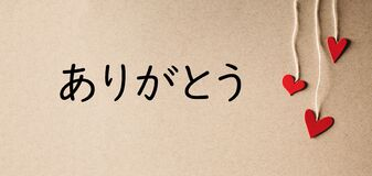 Arigato - Thank you in Japanese language with small hearts