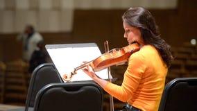 Arina Shevliakova on the rehearsal. Novosibirsk, Russia - December 5, 2014: Arina Shevliakova, the first violin of the chamber orchestra Moscow Soloists on the