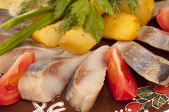 Aringhe con la patata cotta Fotografie Stock Libere da Diritti