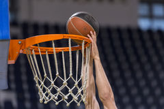 ARIS VS PAOK GREEK BASKET LEAGUE. THESSALONIKI, GREECE – JUN 17, 2015: Undefined player hands throwing a ball through the net prior to the Greek Basket League Royalty Free Stock Images