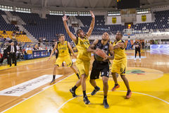 ARIS VS PAOK GREEK BASKET LEAGUE. THESSALONIKI, GREECE, JUN 17, 2015: Carter of Paok (M) in action with Pasalits (L) and Tomas (R) of Aris during the Greek Royalty Free Stock Image