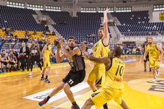 ARIS VS PAOK GREEK BASKET LEAGUE. THESSALONIKI, GREECE, JUN 17, 2015: Margaritis of Paok (L) in action with Vezenkov of Aris (R) during the Greek Basket League Royalty Free Stock Photos