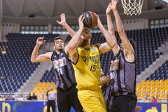 ARIS VS PAOK GREEK BASKET LEAGUE. THESSALONIKI, GREECE, JUN 17, 2015: Naymick of Aris (M) in action with Margaritis (L) and Dedas (R) of Paok during the Greek Royalty Free Stock Photos
