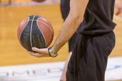 ARIS VS PAOK GREEK BASKET LEAGUE. THESSALONIKI, GREECE, JUN 17, 2015: Undefined player holding a ball prior to the Greek Basket League game Aris vs Paok Stock Images